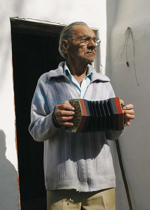 Clemens playing his concertina