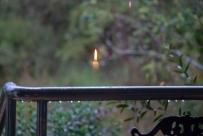 Fairy candle… Magical reflection through window into garden…
